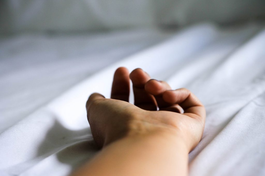 hand on a bed