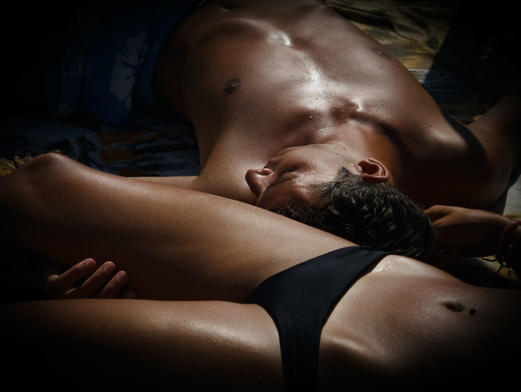 Man and woman lying down in underwear